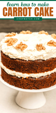 Carrot cake with raisins on a cake stand.