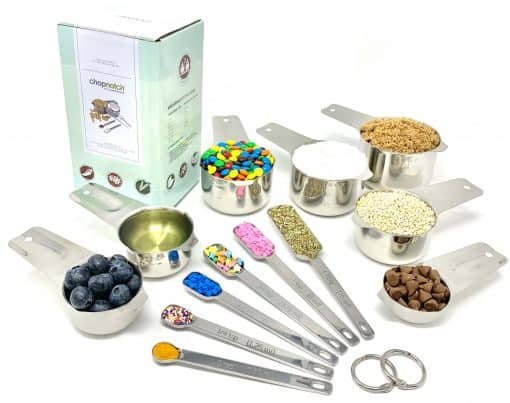 A set of Chopnotch measuring cups and spoons laid out for display.