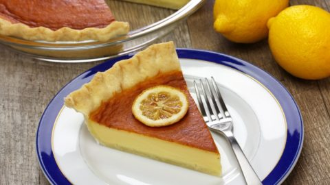 A slice of southern buttermilk pie on a plate with a fork.