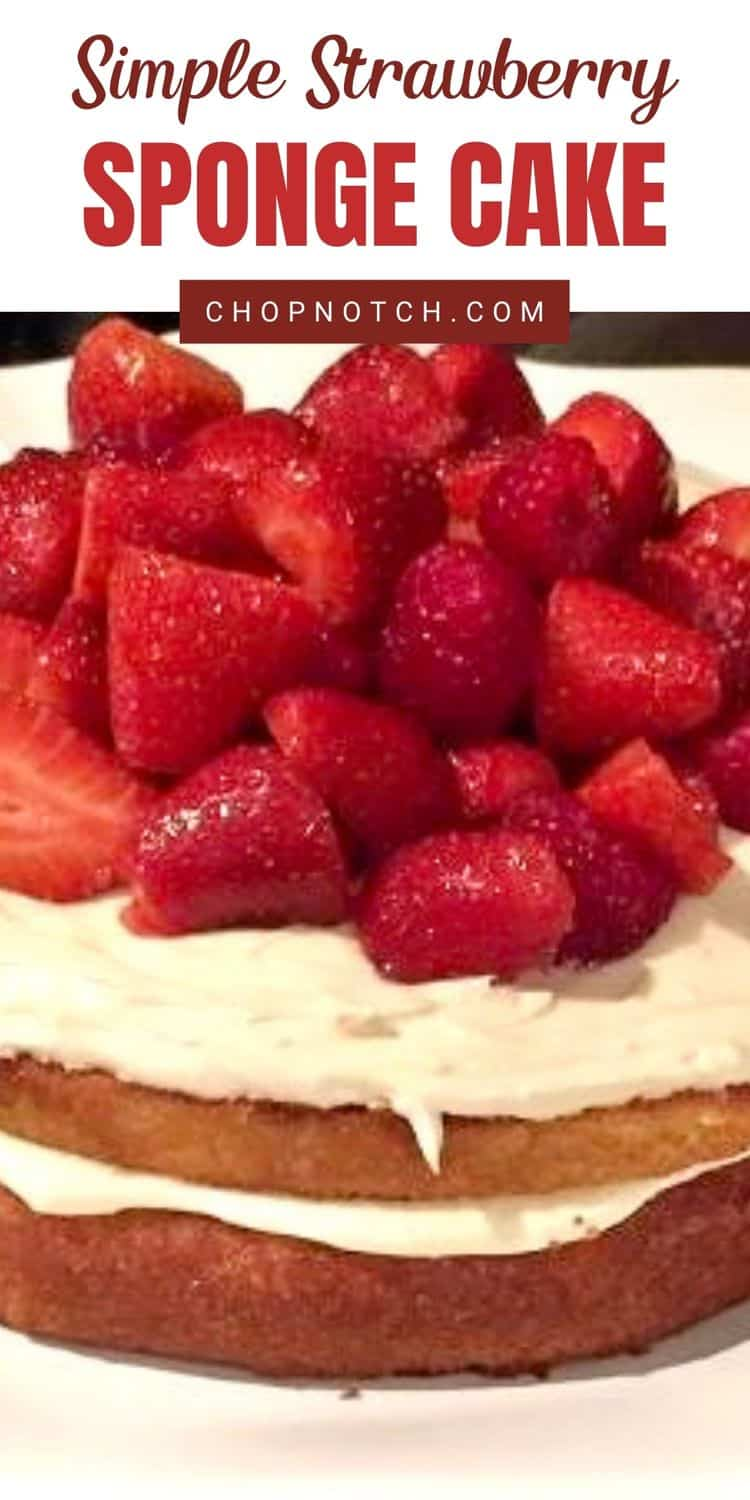 A strawberry sponge cake topped with fresh strawberries.
