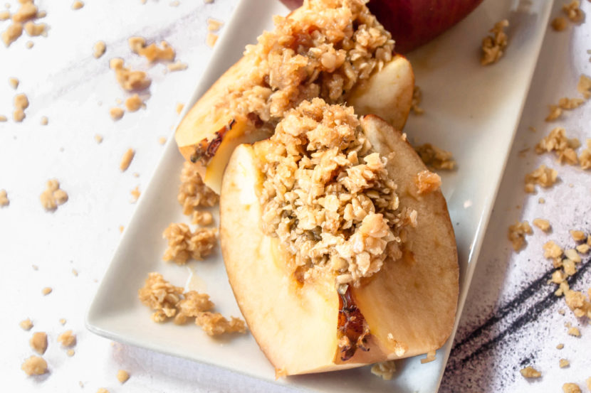 A close up of the best oatmeal baked apples on a serving dish.