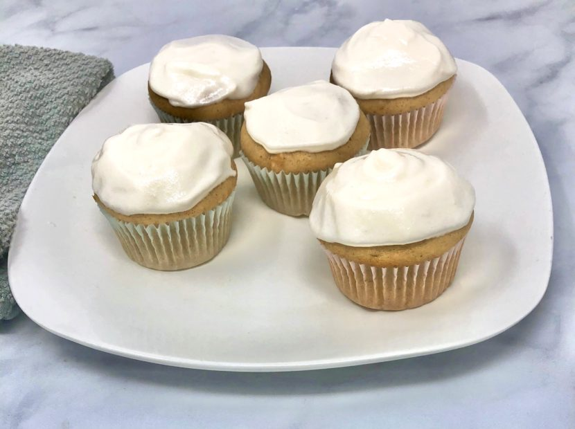 A handful of sweet potato cupcakes on a plate on a table.