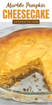 Marble pumpkin cheesecake in a baking dish with a slice cut out.