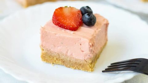 No-bake strawberry cheesecake bars on a plate.