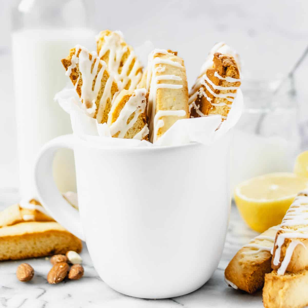 Several biscotti cookies in a mug.