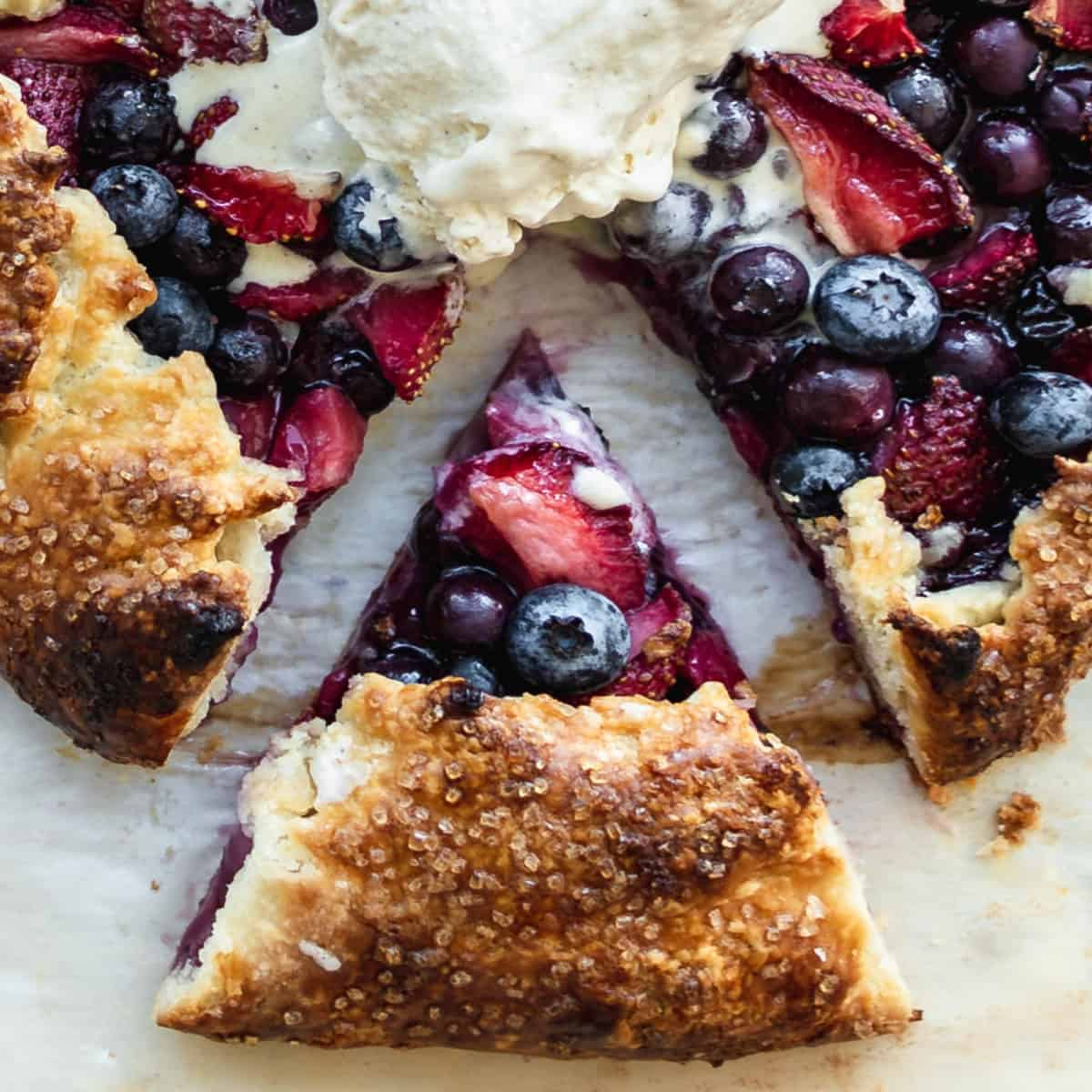 A slice of blueberry and strawberry pie up close.