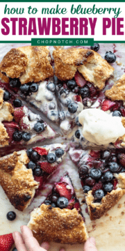 Blueberry and strawberry pie on a table.