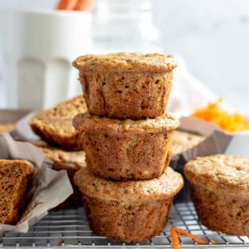 Carrot banana muffins stacked on each other.