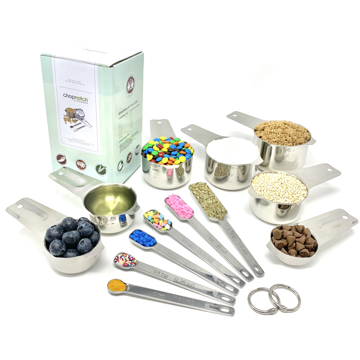 The measuring cups and spoons spread out and filled with ingredients.