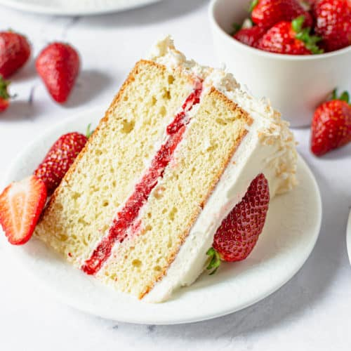 A slice of coconut strawberry cake up close.