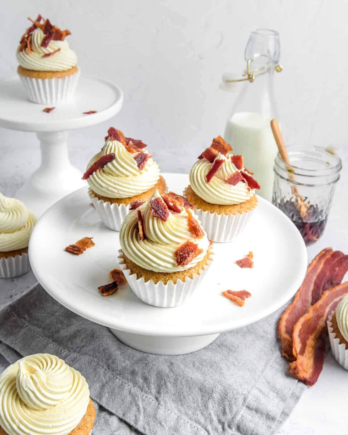 Several finished cupcakes from overhead with bacon on the top.