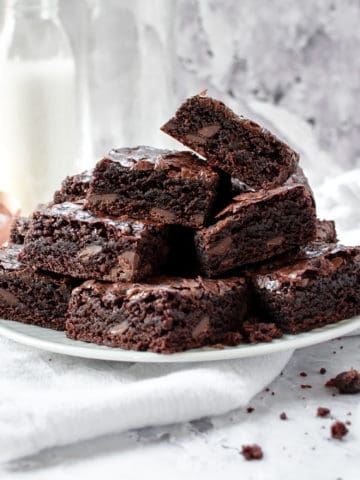 A pile of dairy free brownies in a plate.