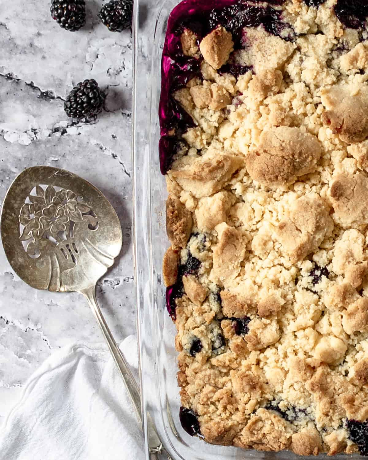 Close up of blackberry cobbler finished in a baking dish.