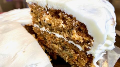 A slice of carrot cake being served.