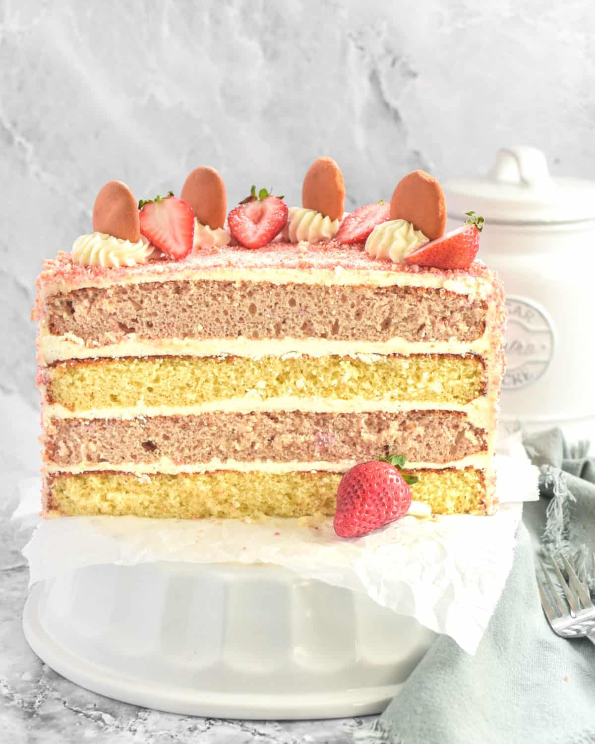 Showing the layers inside a strawberry cake.