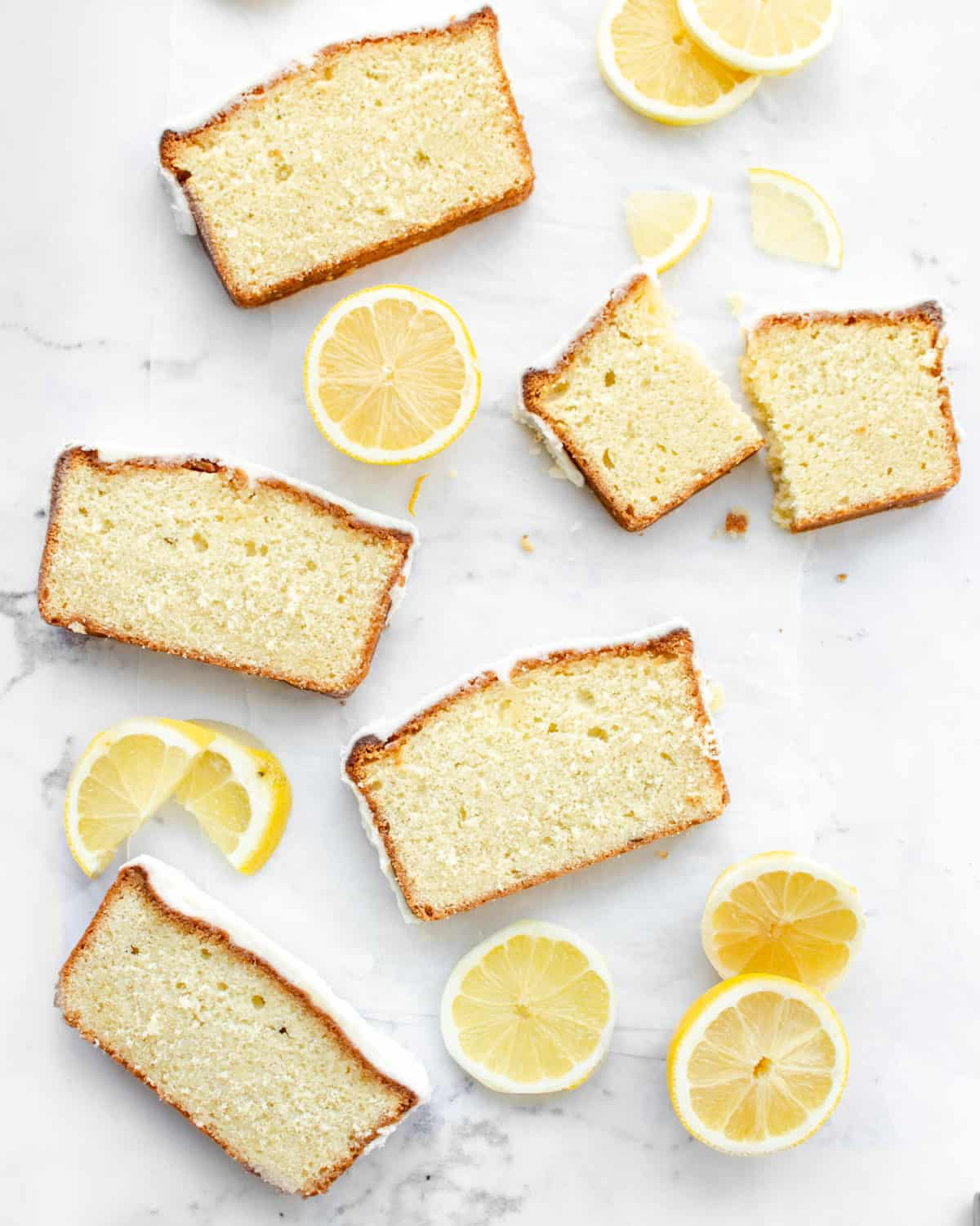 Multiple slices of lemon pound cake on a table.