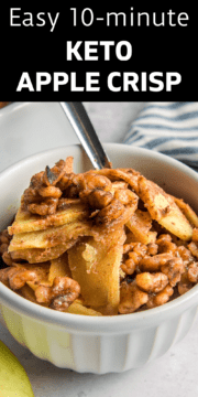 Finished keto apple crisp in a white bowl with a spoon ready to serve.