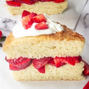 A slice of layered strawberry shortcake.