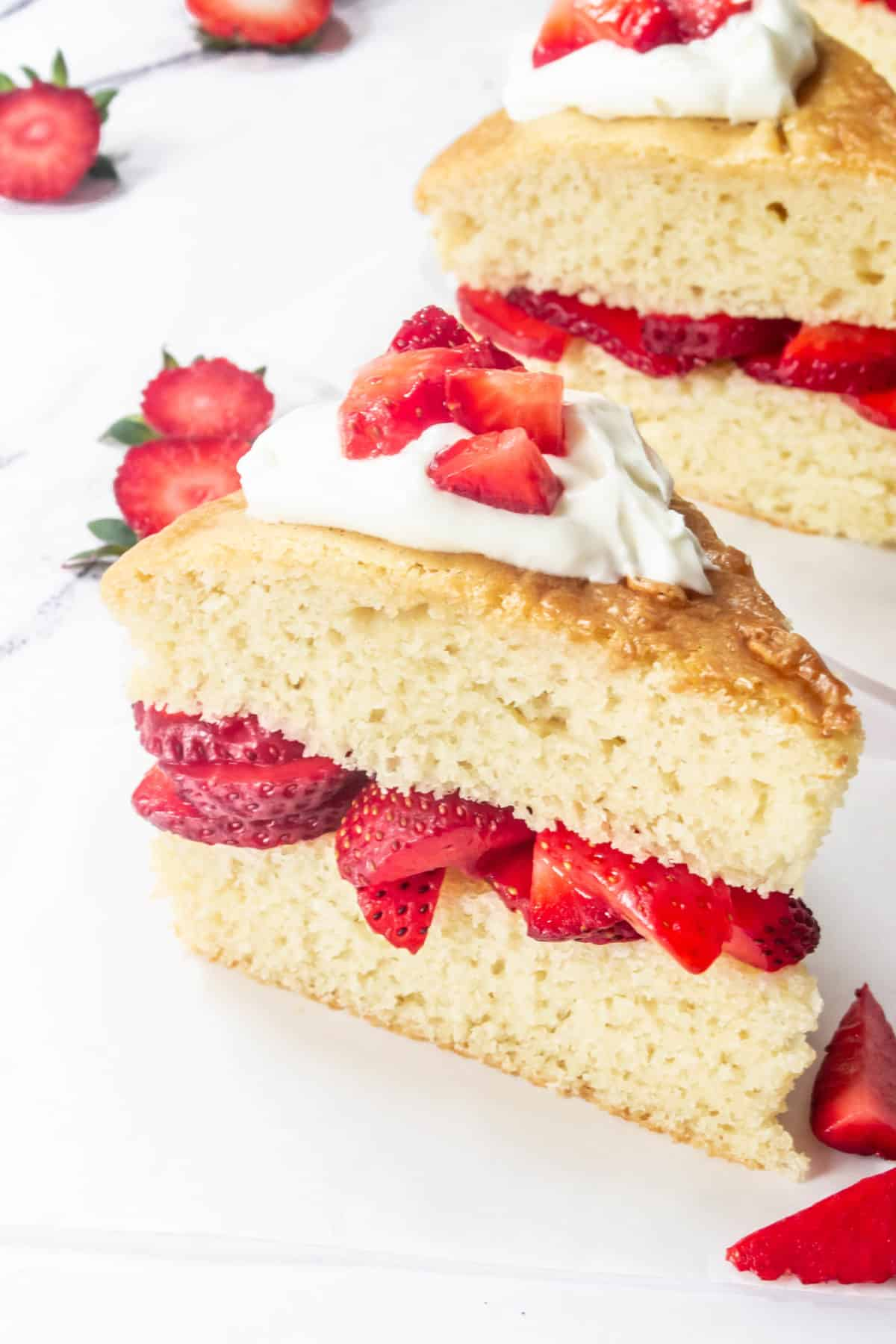 Strawberry shortcake topped with whipped cream.