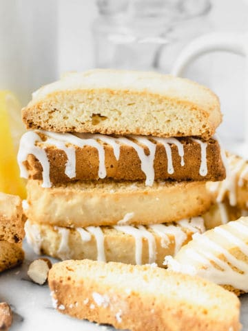 Several lemon biscotti stacked on each other.
