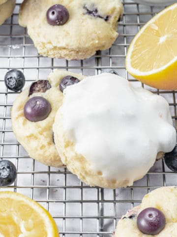 Blueberry cookies with lemon on a cooling rack.