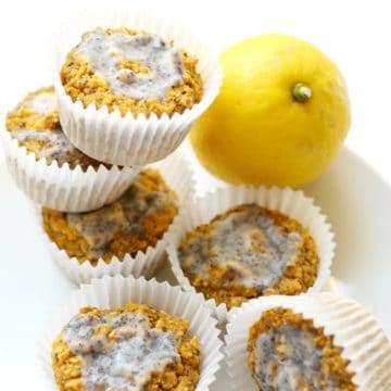 Lemon poppy seed muffins stacked on each other.