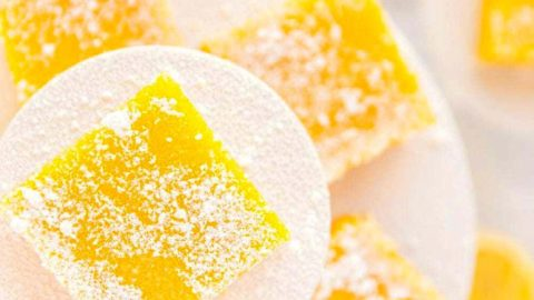 Several lemon squares on a serving stand.