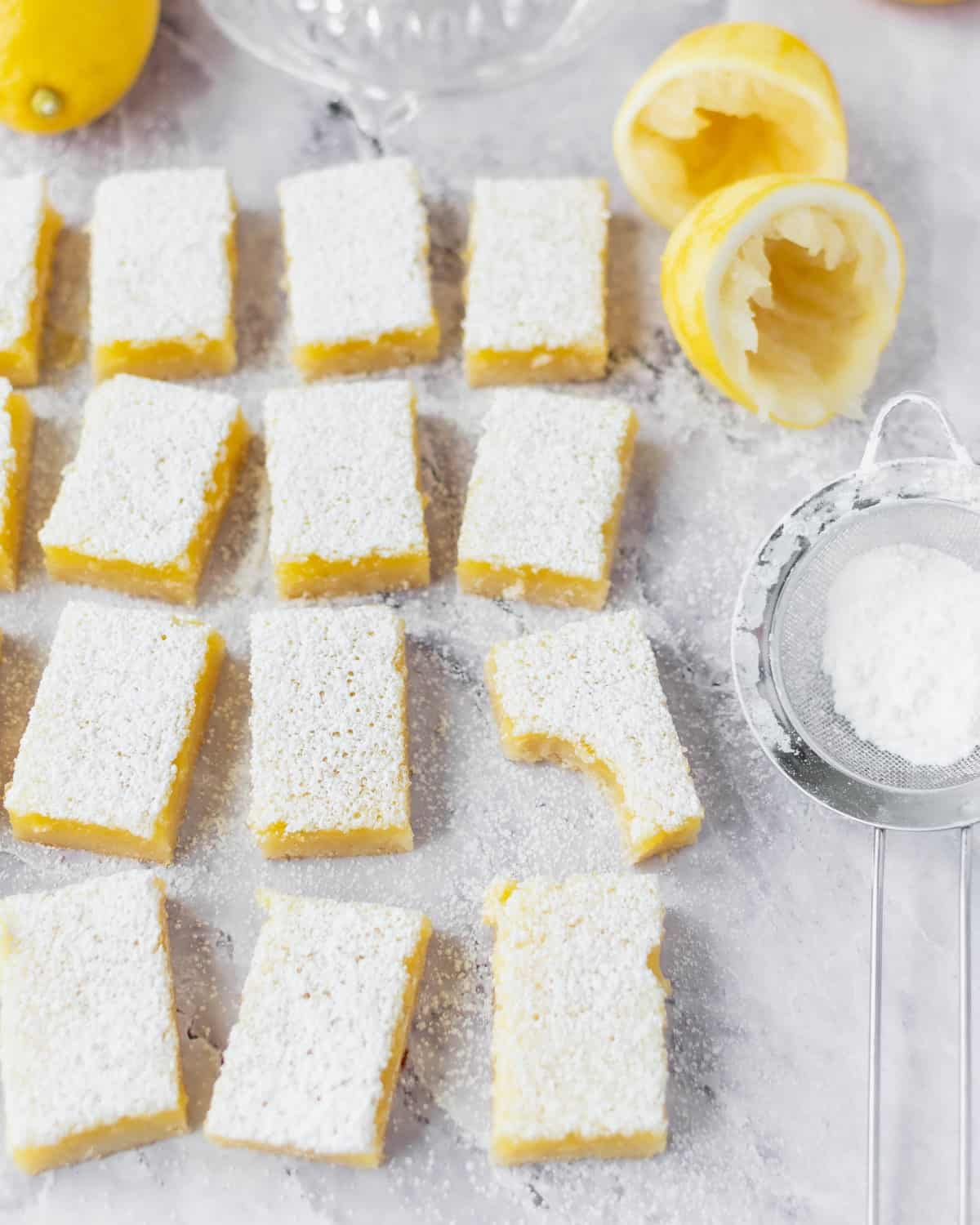 Several lemon bars spread out on a table.