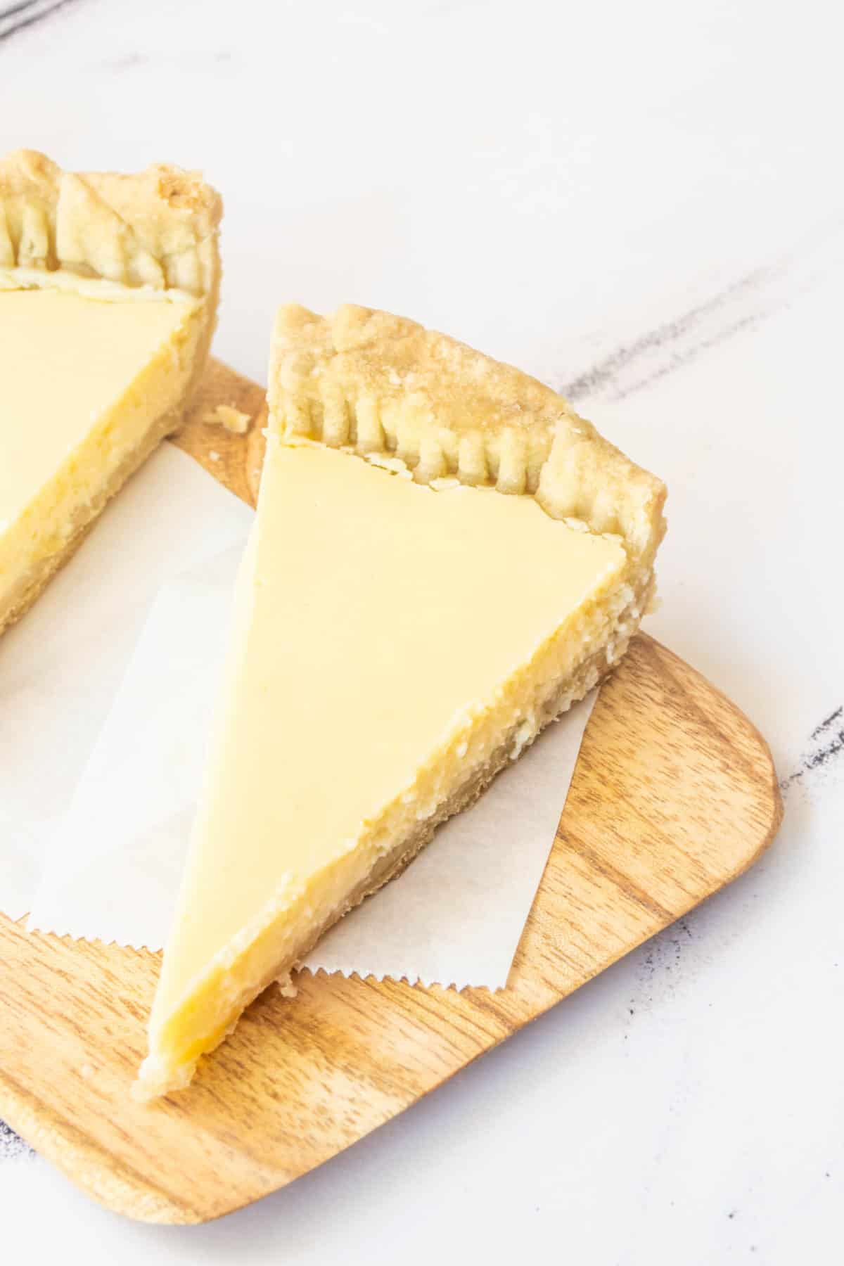 Two slices of Meyer lemon pie on a table.