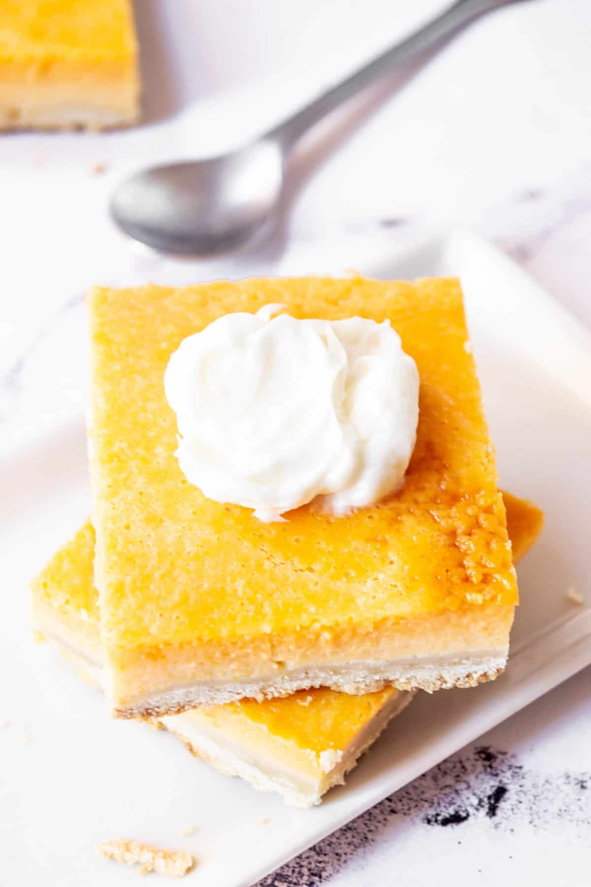 Pumpkin pie bars on a plate with a spoon.
