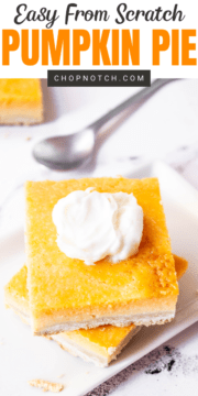 Two pumpkin pie bars stacked on each other on a plate.