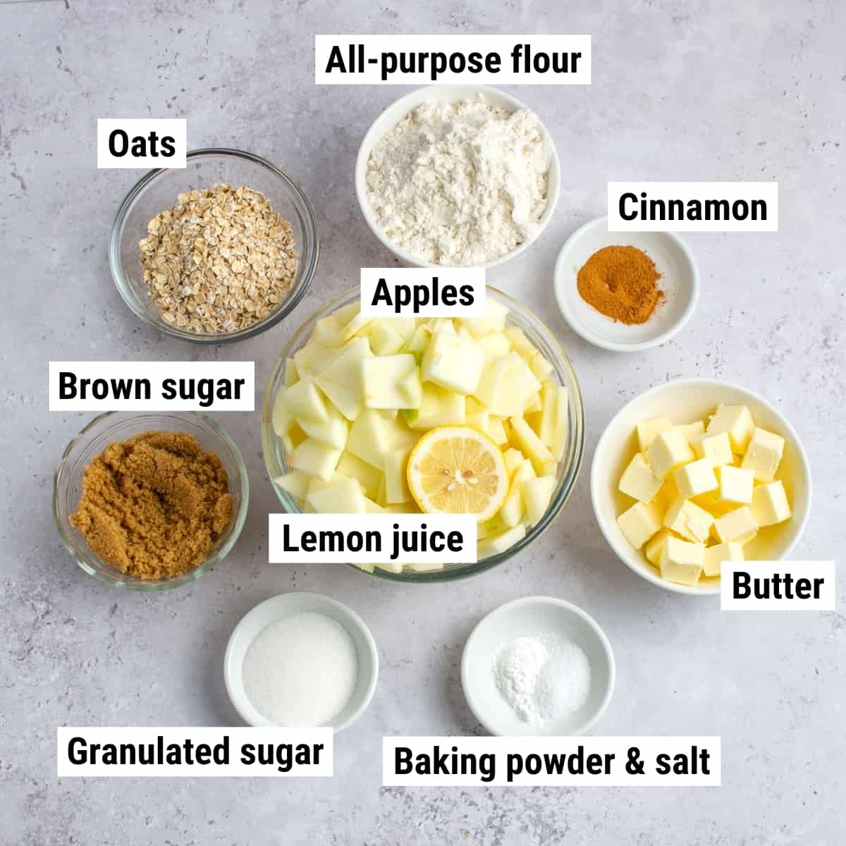 The ingredients to make apple crisp bars laid out on a table.