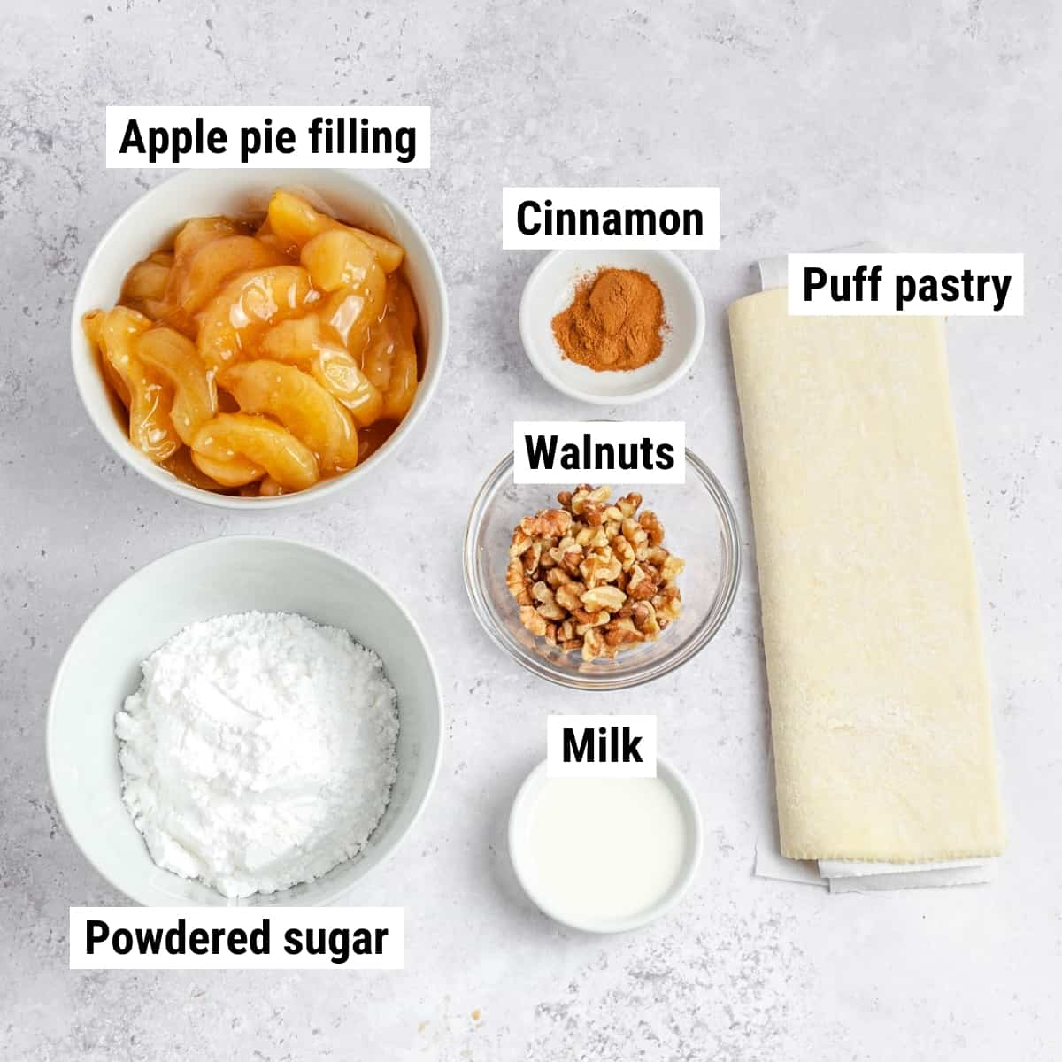 The ingredients used to make apply pie puff pastry spread out on a table.