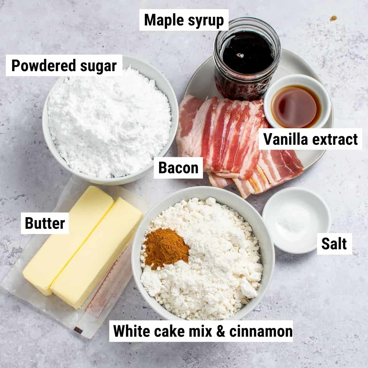 The ingredients used to make bacon maple cupcakes spread out on a table.