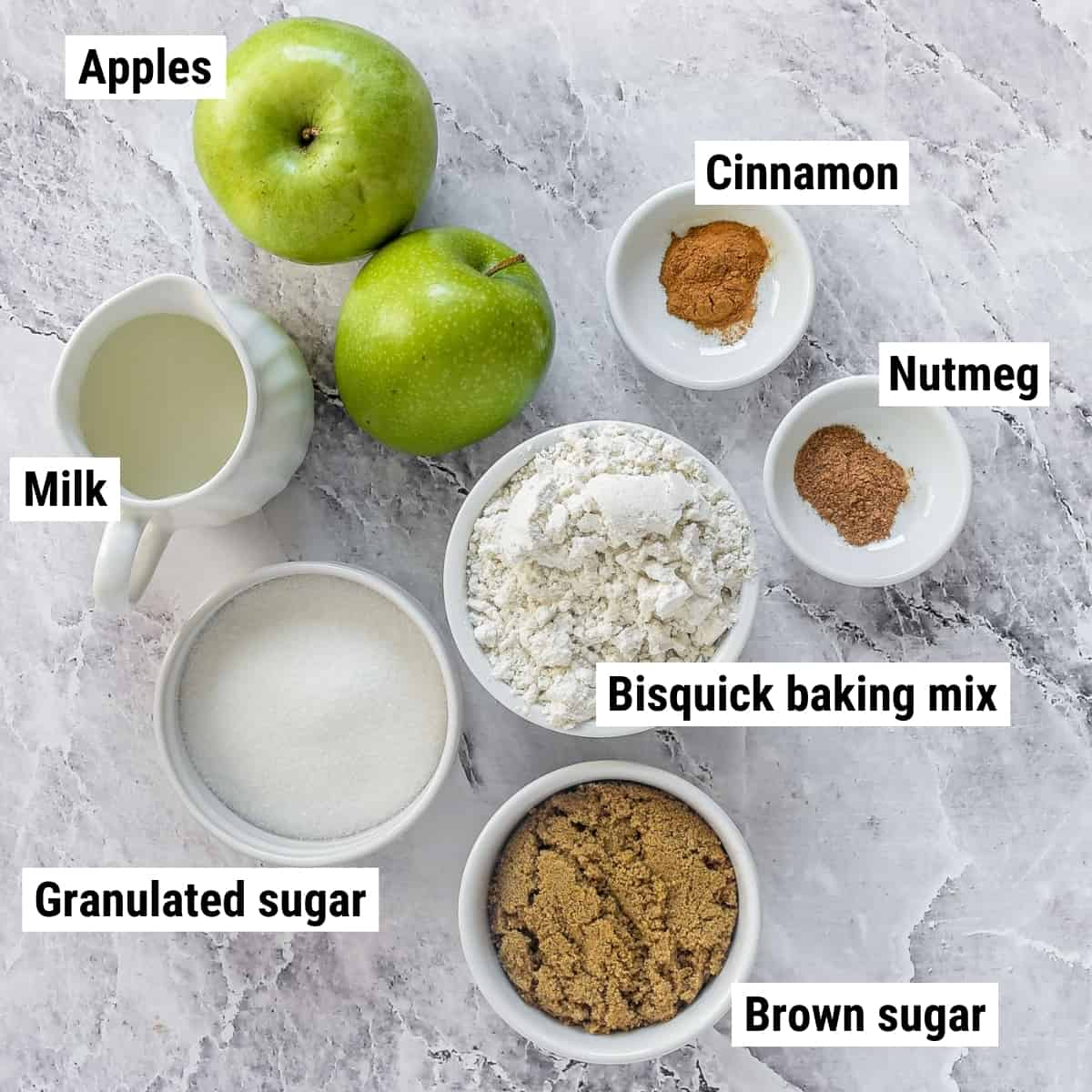 The ingredients for bisquick apple cobbler spread out on a table.