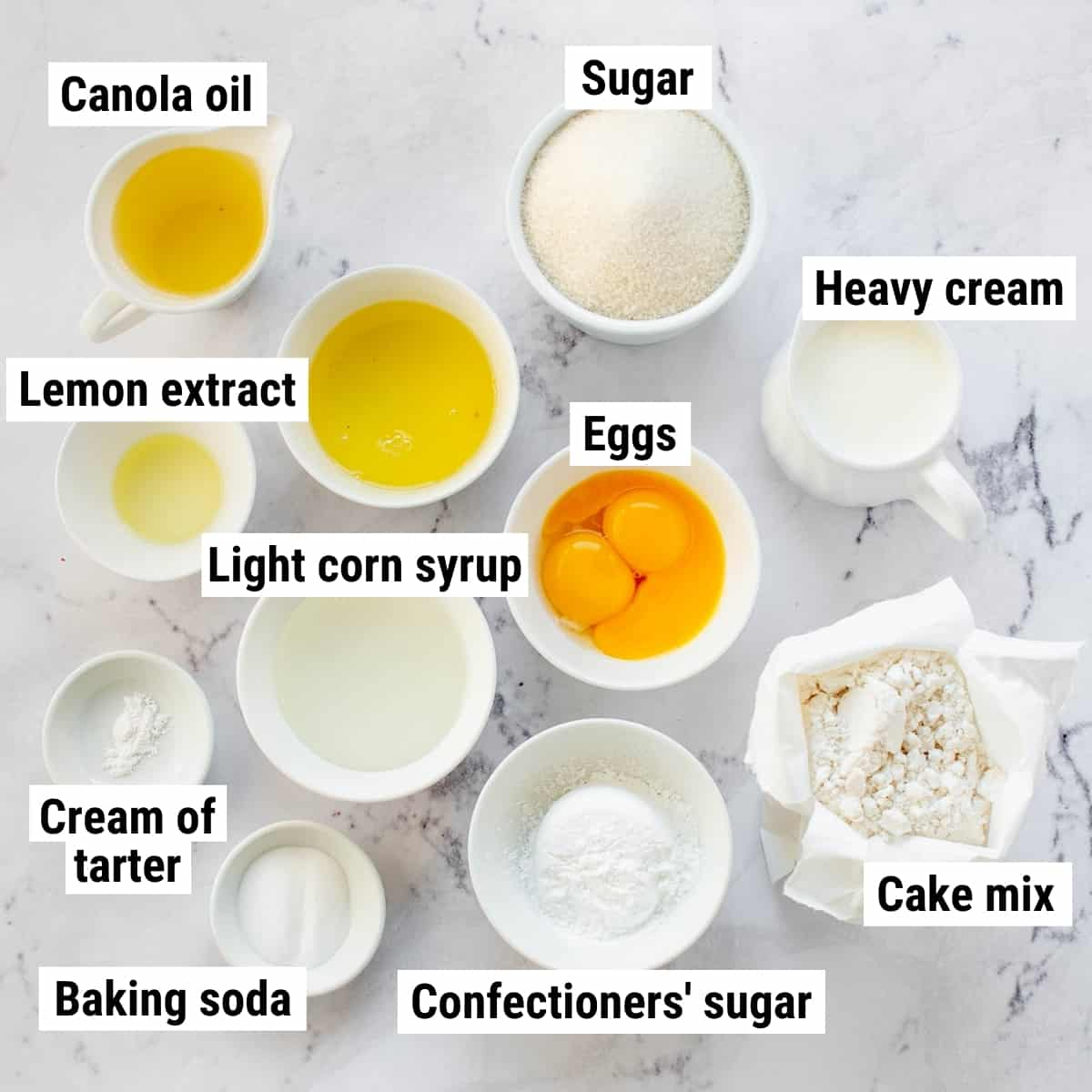 The ingredients to make lemon crunch cake laid out on a table.