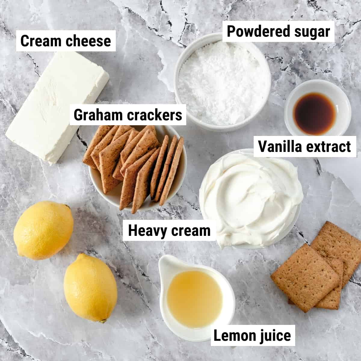 The ingredients to make a lemon icebox cake laid out on a table.