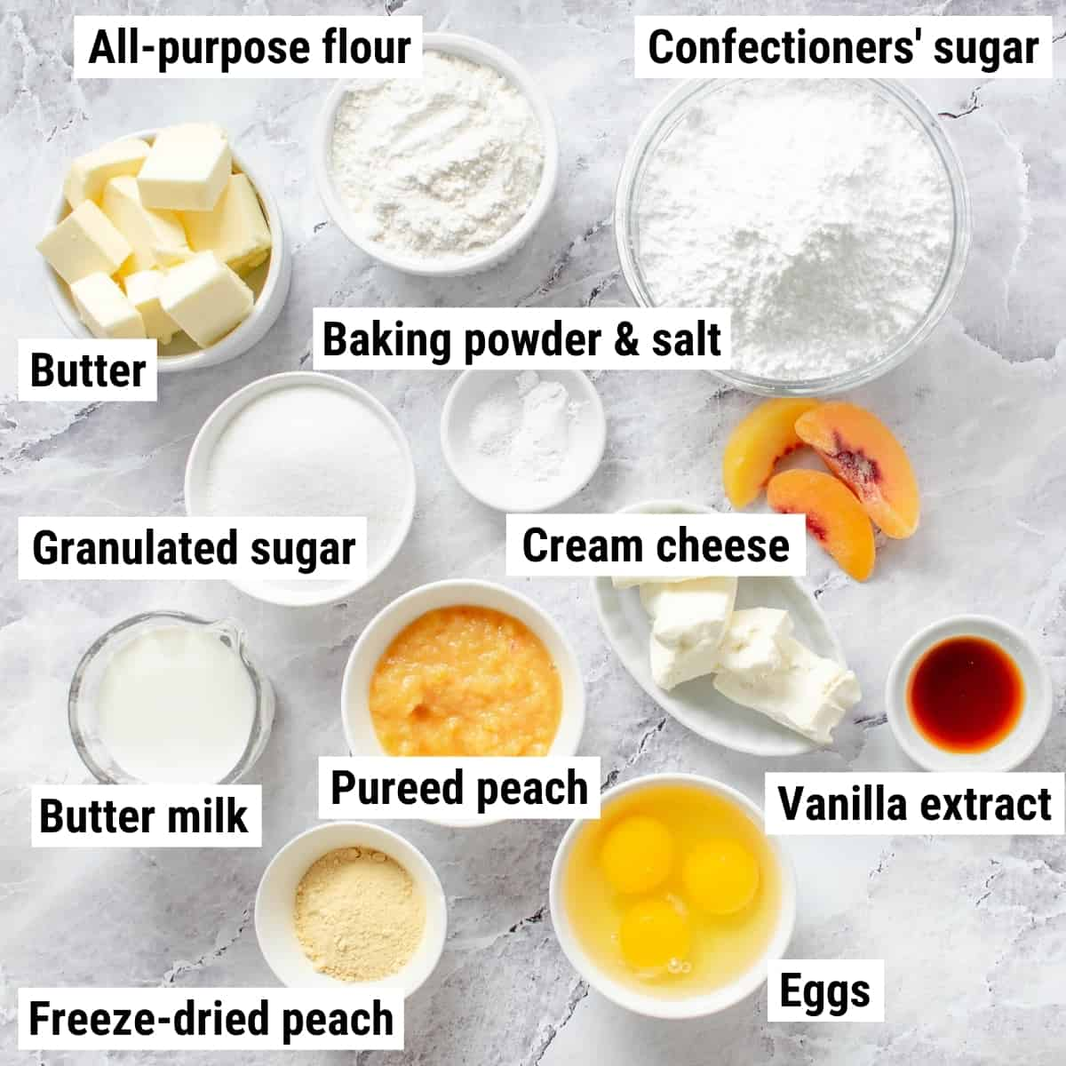 The ingredients to make peach cupcakes spread out on a table.