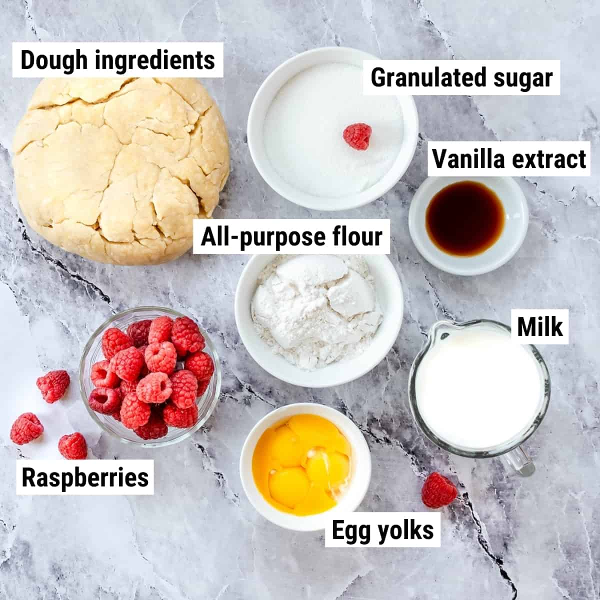 The ingredients to make raspberry custard tart laid out on a table.