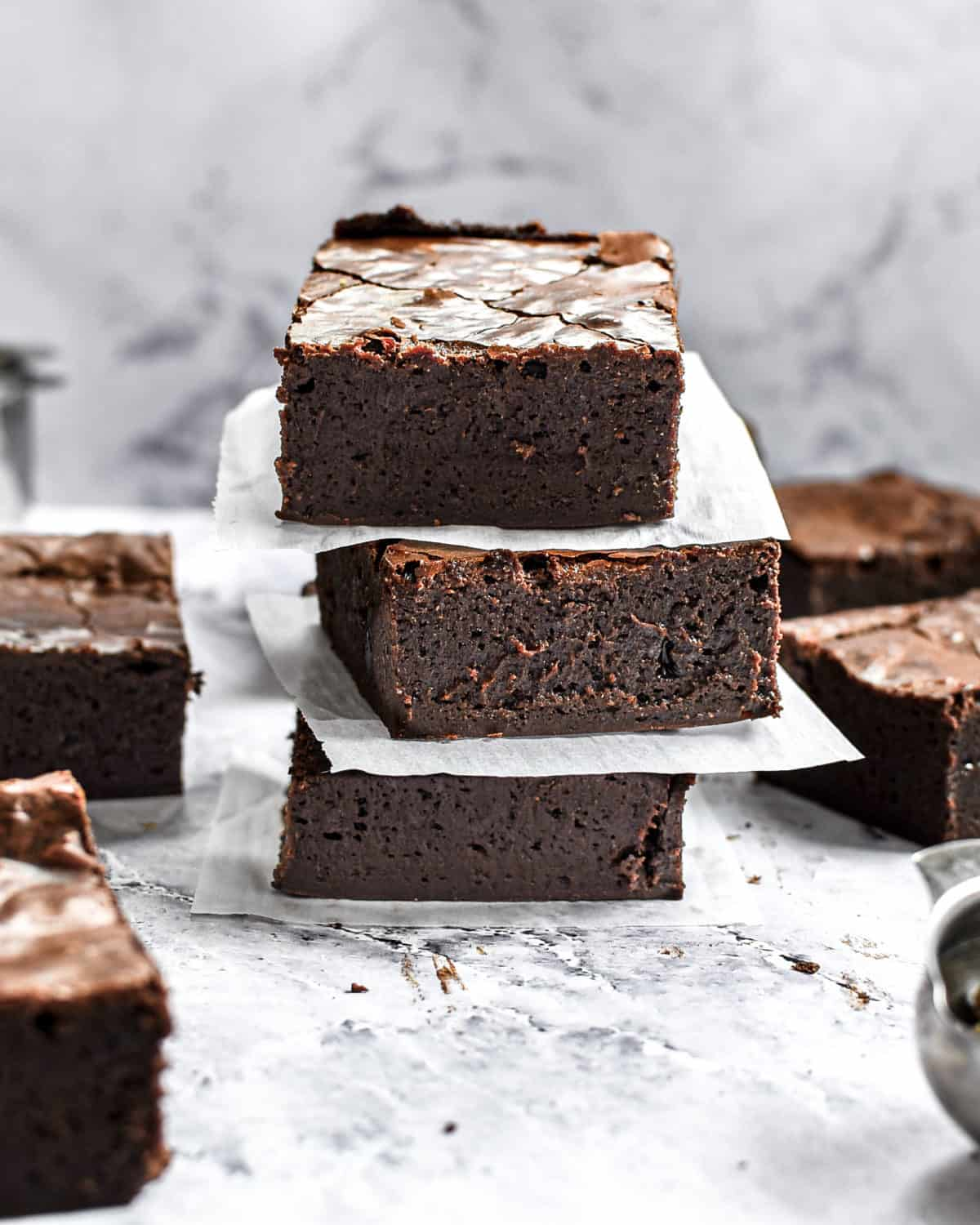 A stack of three brownies on top of each other.