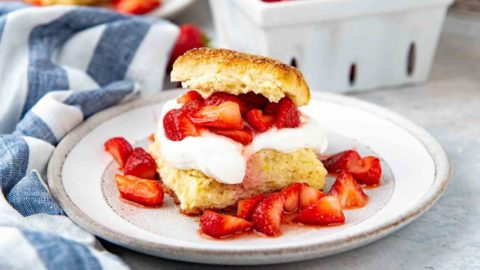 A slice of easy strawberry shortcake on a dish.