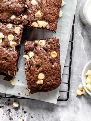 A white chocolate chip brownie up close.