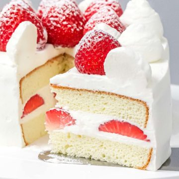 Japanese style strawberry shortcake on a cake stand.