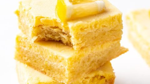 Three lemon bars stacked on each other.