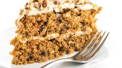 A slice of sugar-free carrot cake on a plate.